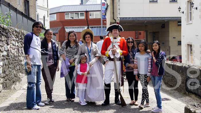 Visitors pose with our guests from the 18th century during Walls400's Living History on the Walls event.